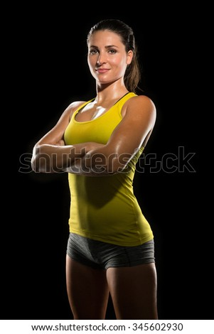 Intense determined athlete champion sweaty confident woman female powerful fighter physical trainer strong pose - stock photo
