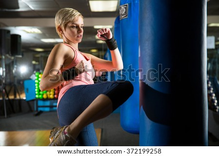 Intense fat burn exercise fitness routine kickboxing gym for self defense and independent strength - stock photo