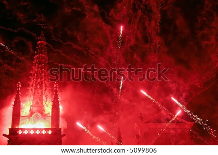 intense red fireworks on a christian church with  dense smoke