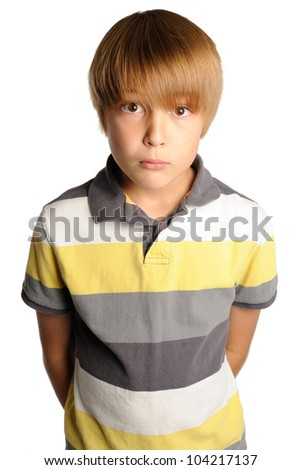 Intense Stare from a Young Boy. Nine year old boy staring directly at the viewer with an intense look. Isolated on white.