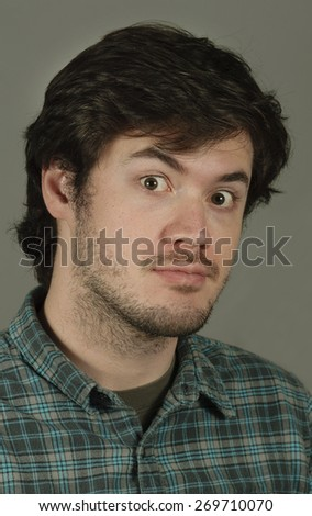Intense young man - stock photo