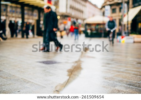 intentional blurred city and people urban milan scene background