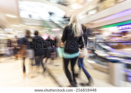 Intentional Blurred Image of People in Shopping Center  - stock photo