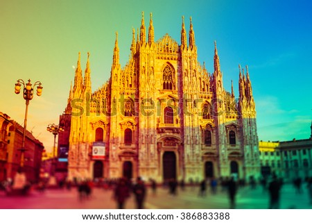 Intentionally blurred colorful filtered view of Duomo, the most important cathedral in Milan - stock photo