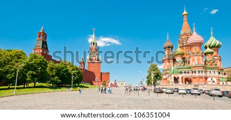 Intercession Cathedral (St. Basil's) and the Spassky Tower of Moscow Kremlin at Red Square in Moscow, Russia - stock photo