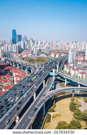 interchange of viaducts on traffic rush hour in shanghai - stock photo