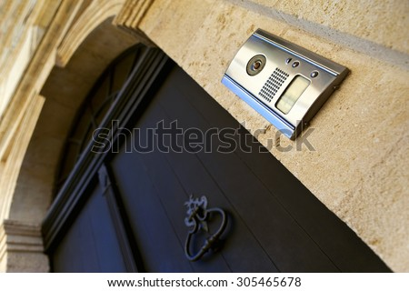 Intercom and door knocker on the facade of a French mansion