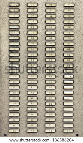 Intercom buttons for apartments in a city building - stock photo