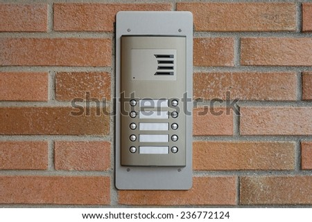 intercom on a brick wall - stock photo