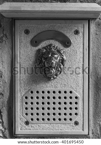 intercom system, the image of a lion from the yellow metal - stock photo