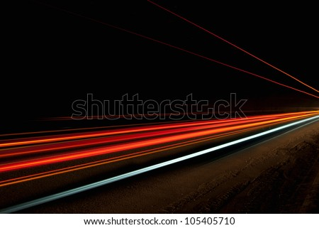 Interesting and abstract lights in a tunnel in orange that can be used as background or texture - stock photo