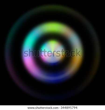 Interesting and unusual illustration of 3 blurred concentric circles - 2 inner in rainbow colors and the outer one almost not visible; on black background - stock photo