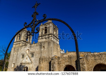 Interesting Angle with View of Crosses of the Historic Old West Spanish Mission Concepcion, Established 1716, San Antonio, Texas.  Shot Taken December 2012. - stock photo
