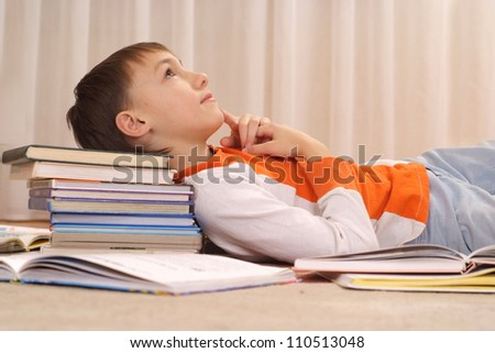 Interesting Boy Does Homework At Home Alone Stock
