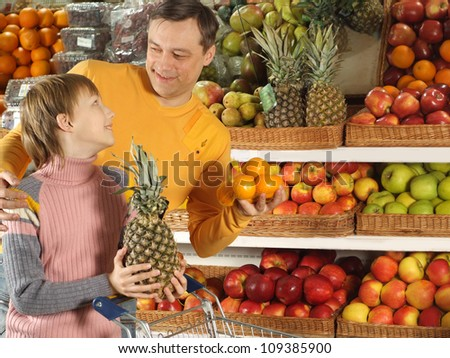 Interesting boy with dad chooses products in the store