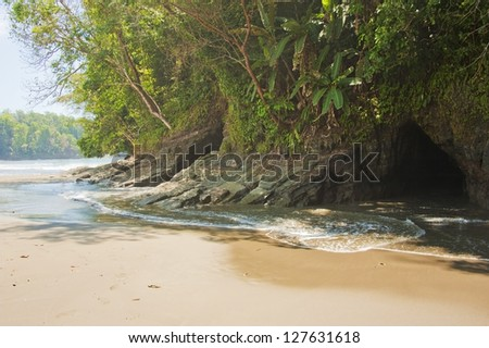 Interesting caves created by wave action at Playa Ventenas Costa Rica. - stock photo