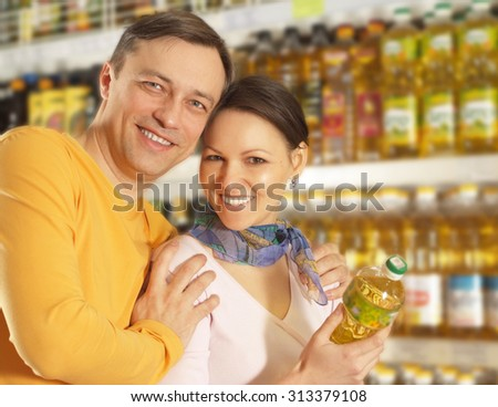Interesting couple chooses products in the store