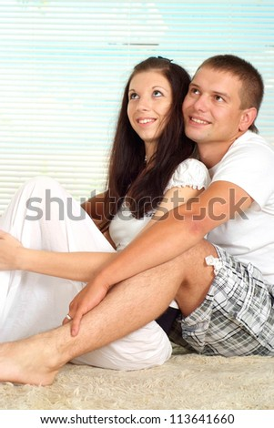 Interesting couple enjoying each other's company at home
