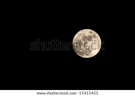 Interesting full moon in night black background - stock photo
