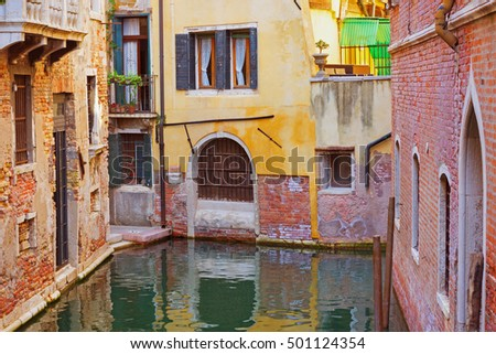Interesting place in Venice, Italy. Venetian colorful old-style buildings surrounded by water.