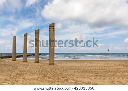 interesting posts on the beach on sky background in Haifa - stock photo