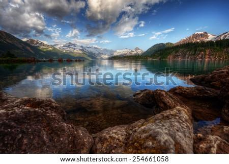 Interesting rocky mountain lakeside - stock photo