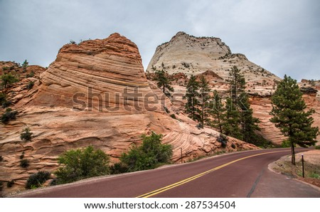 Interesting stone formations with tourist highway in the foreground.  - stock photo