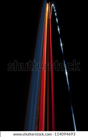 Interesting vertical abstract image of blue, red, orange and white lights