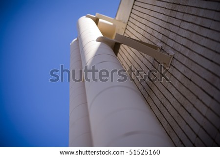 Interesting view of building and vent pipe