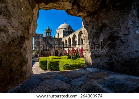 Interesting View Through a Window Through Thick Stone Walls of the Court Yard of the Historic Old West Spanish Mission San Jose, Founded in 1720, San Antonio, Texas,  - stock photo