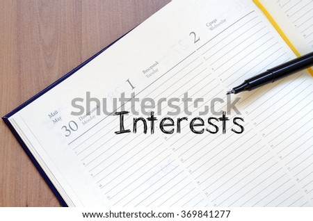 Interests text concept write on notebook with pen