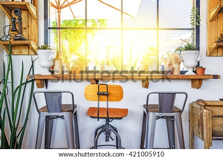 Interior and decoration of a coffee shop, Different chairs in the cafe. - stock photo