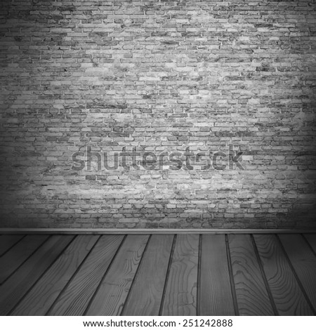 interior background, brick wall texture and wooden floor in black and white - stock photo