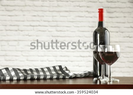 interior background with white wall and bottle of wine  - stock photo