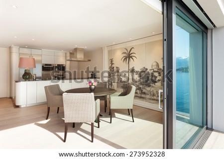 Interior beautiful apartment, elegant dining room view from veranda - stock photo