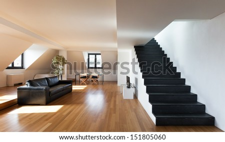 Interior, beautiful loft, hardwood floor, view living room - stock photo