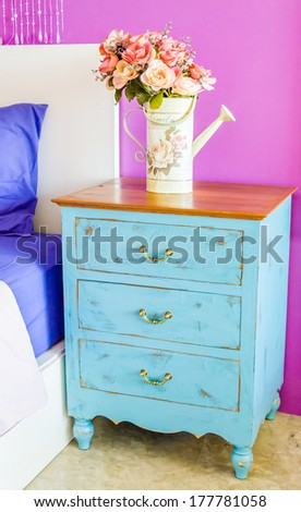 Interior bed room vase flower on wood beside bed table - stock photo