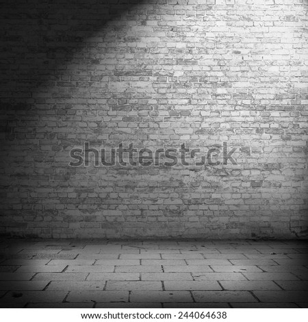 interior brick wall background texture in basement with beam of spot light - stock photo