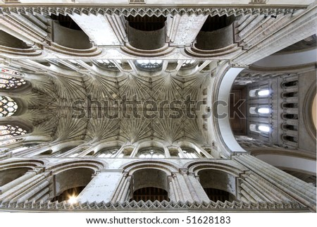 Interior ceiling  of the nave of Norwich Cathedral showing arches and bosses. - stock photo