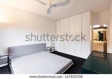 interior, comfortable loft, modern furniture, bedroom - stock photo
