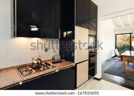 interior, comfortable loft, modern kitchen - stock photo