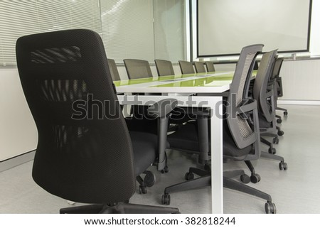 Interior conference room, meeting room, with white projector board.