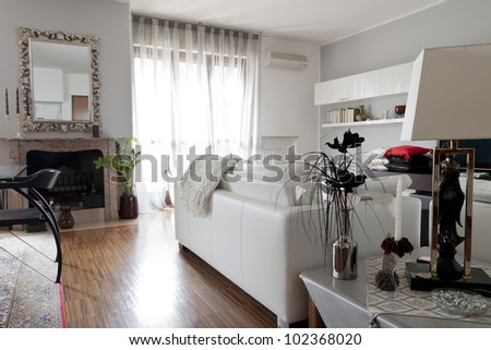 Interior decoration of a living room, couch and mirror - stock photo