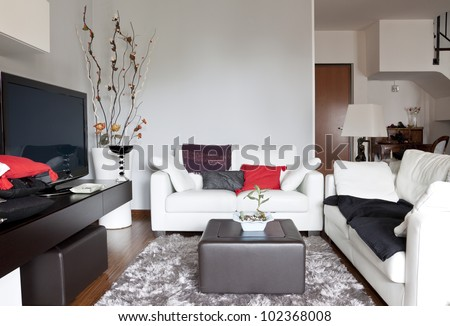 Interior decoration of a living room, sofa and tv - stock photo