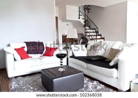 Interior decoration of a lounge, modern white sofa - stock photo