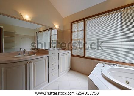 Interior design: Beautiful luxury bathroom with big bathtub - stock photo
