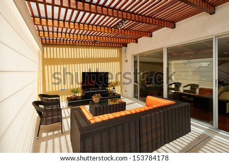 Interior design: Beautiful modern terrace lounge with pergola - stock photo