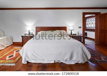 Interior design: Big classic bedroom with big empty white wall - stock photo