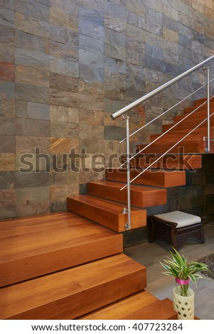 Interior design: Classic wooden stairs and stone wall - stock photo
