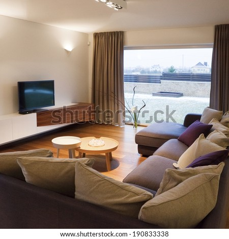 Interior design - cozy living room with TV set and large window  - stock photo